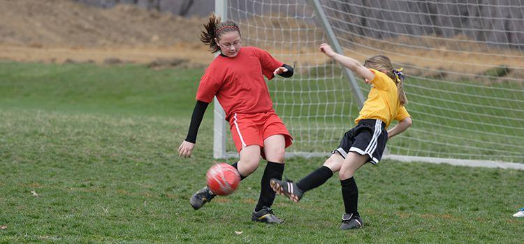 Tween girls playing soccer